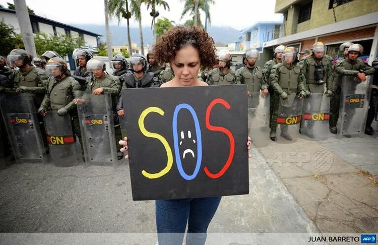 Demonstrator in Cuba - Image via Cuban Exile Quarter.jpg