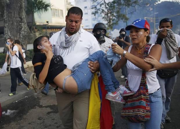 Demonstrators in Venezuela - Image via The Globe and Mail.JPG