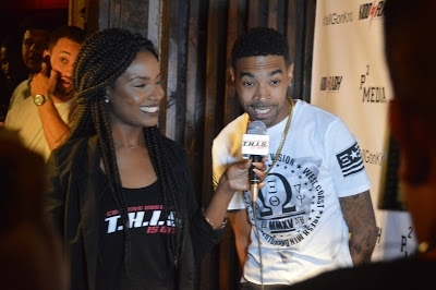 Kidd Flash gives an interview before the party